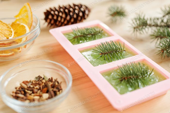 Handmade green soap with conifer in silicone molds and aromatic stuff
