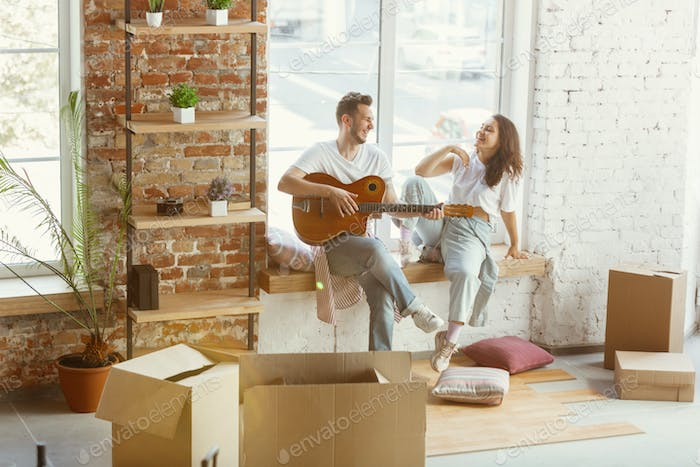 Young couple moved to a new house or apartment
