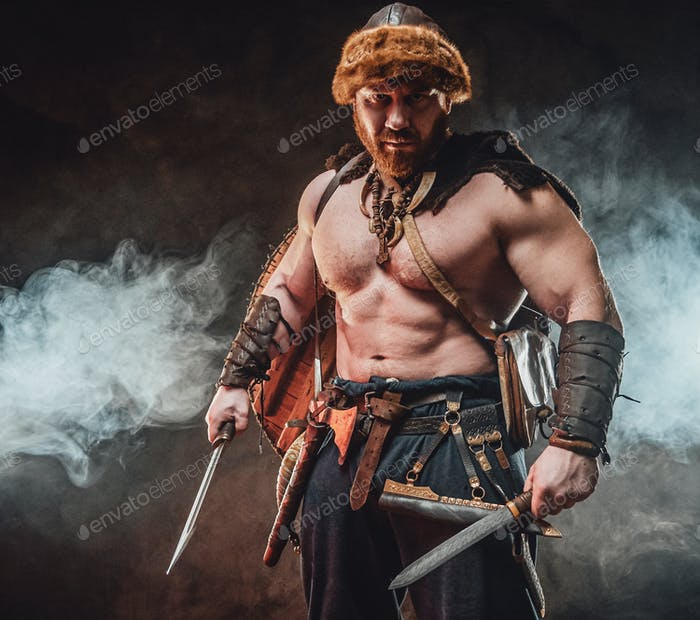 Savage nordic barbarian with hatchet and knife