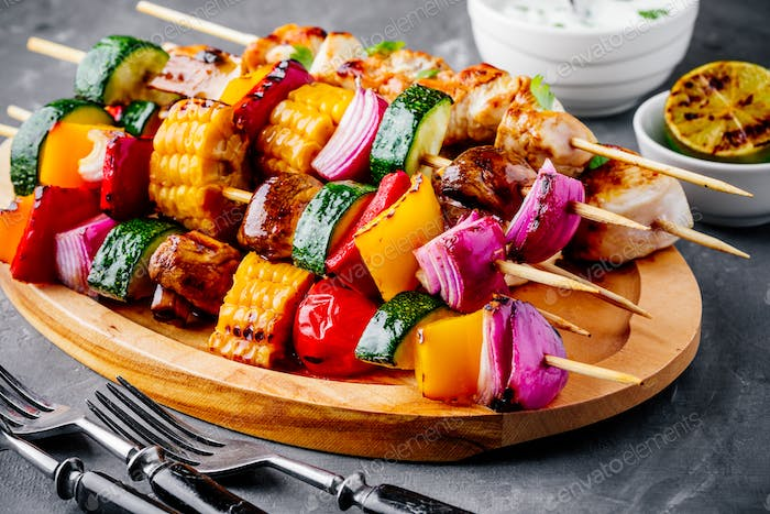 Grilled vegetable and chicken skewers with sweet corn, paprika, zucchini, onion, tomato and mushroom