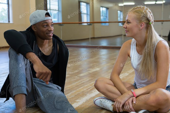 Friends talking in dance studio