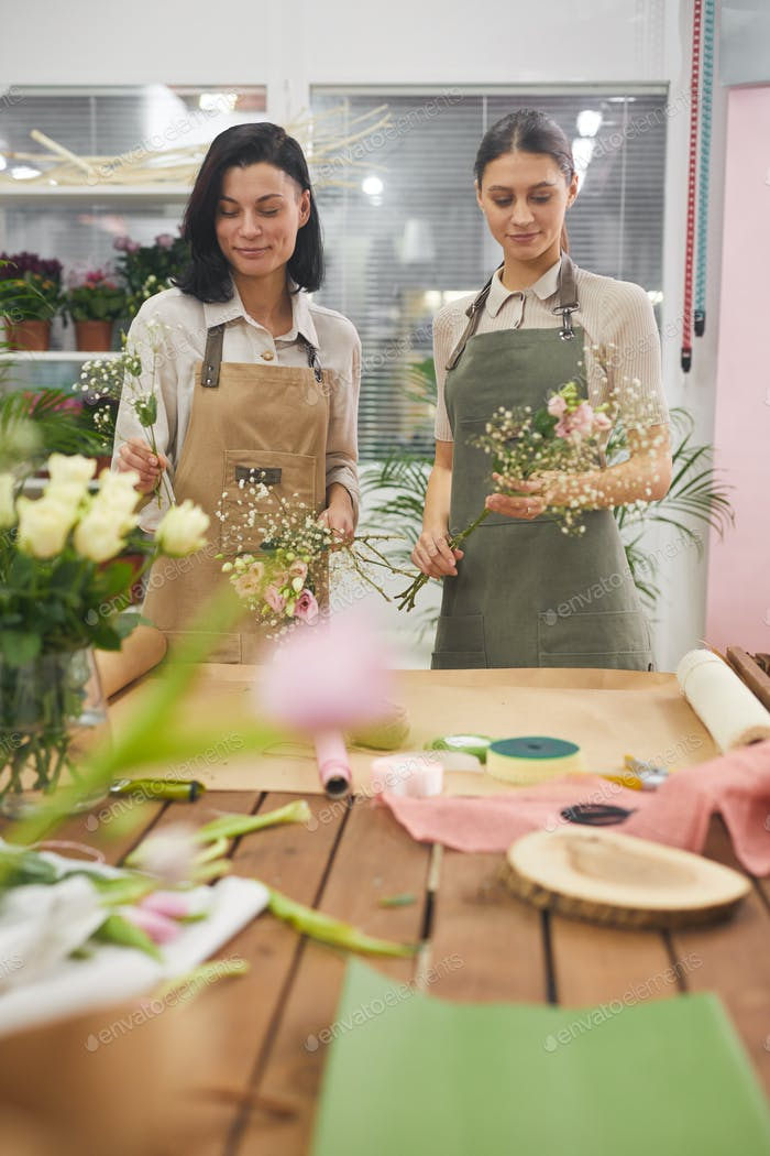 Florists Arranging Bouquet in Flower Shop