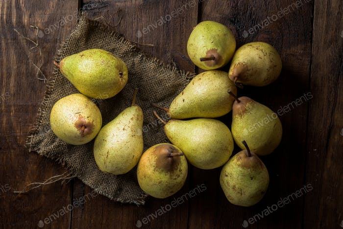 pears on canvas and wooden board