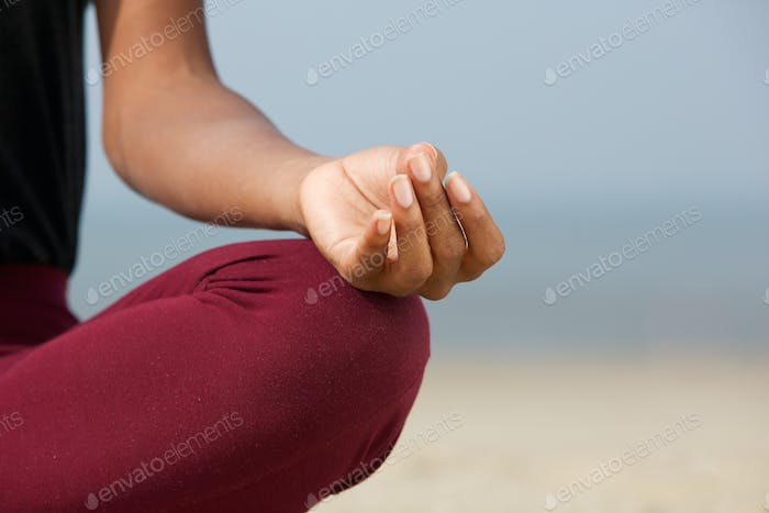 Woman in lotus position at the beach