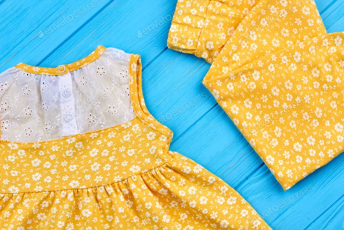 Close up of natural outfit for baby-girl