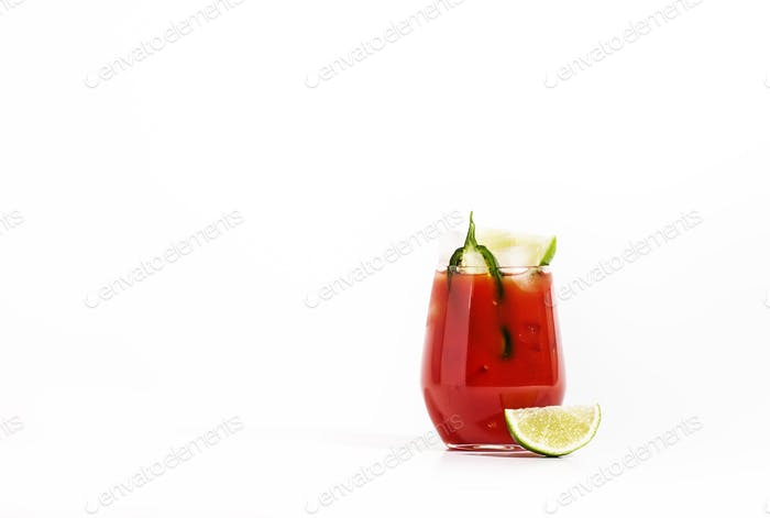alcoholic cocktail with vodka, tomato juice, jalapeno pepper, lime and salt