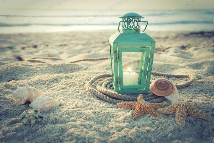 Lantern on a Tropical Beach at Sunrise