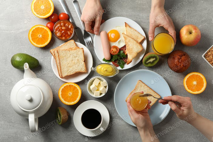Delicious breakfast or lunch background. Grey table. People eat