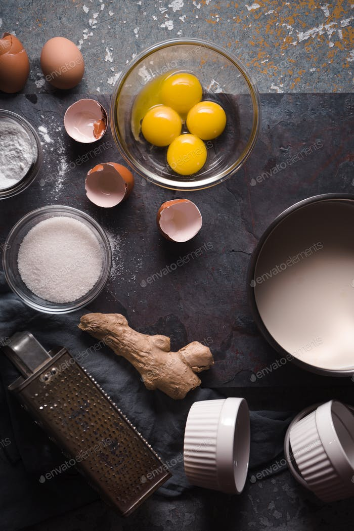 Ingredients for Catalan cream on the stone background vertical