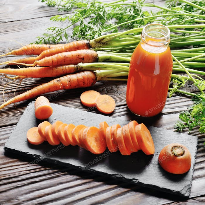 Closeup view at fresh organic vegetarian carrot juice in bottle