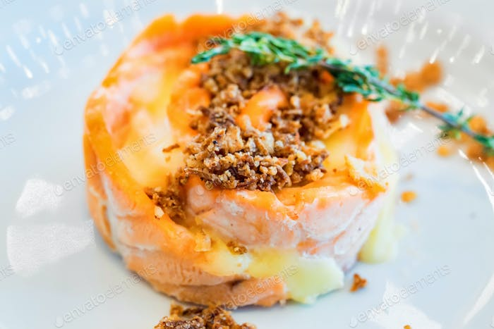 Salmon salad with potato, nuts and rosemary