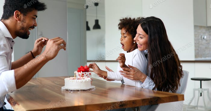 Happy family having fun times and celebrate birthday