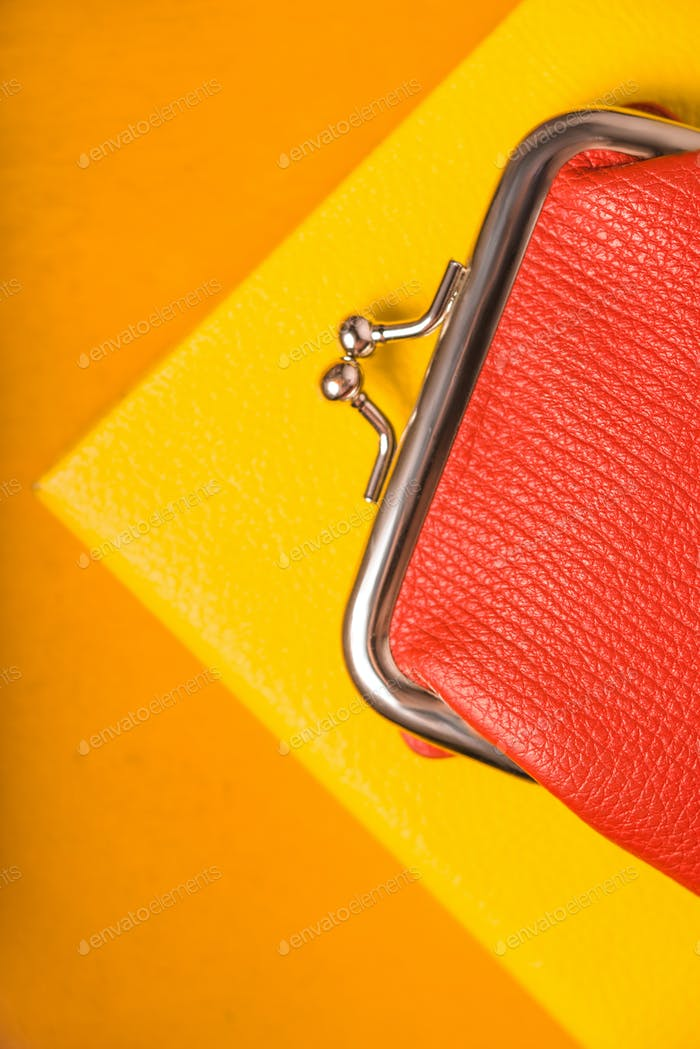 Orange purse on the bright yellow background