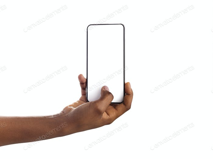 Woman hand holding and touching blank smartphone screen with thumb