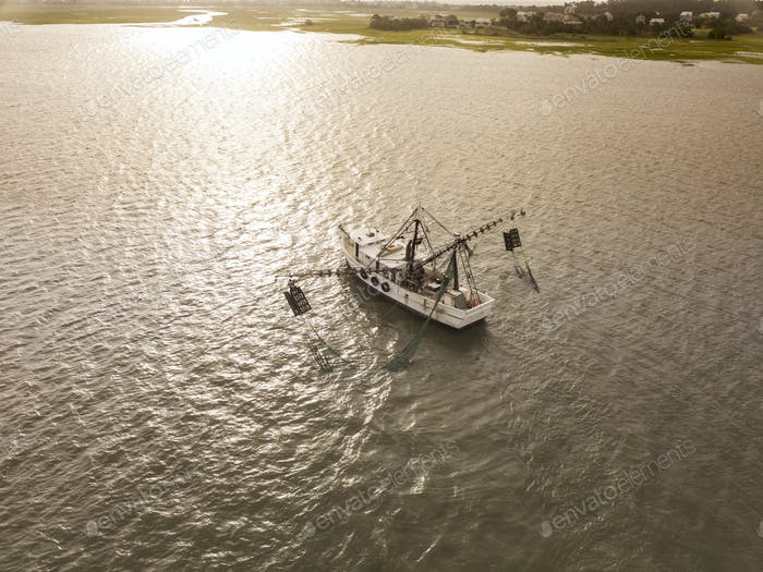 Aerial view of shrimp boat off the coast of South Carolina at su