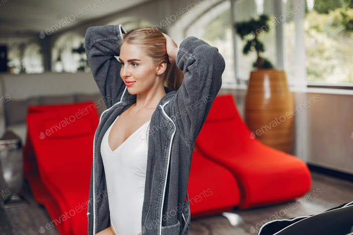 Beautiful girl relaxing in a spa salon