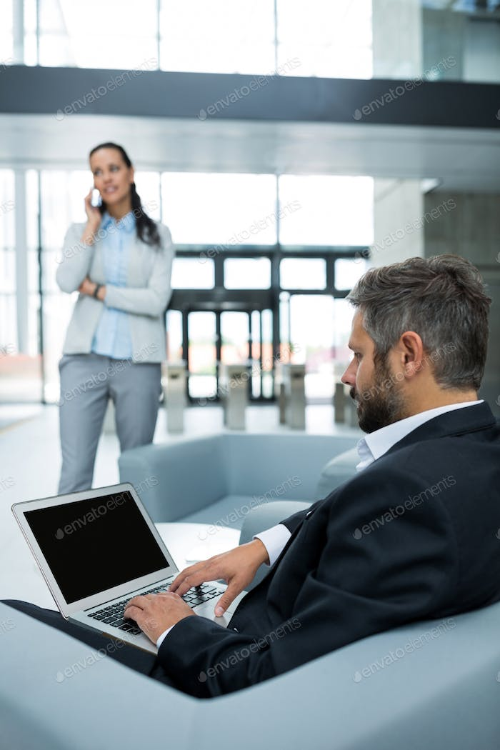Businessman sitting and using laptop