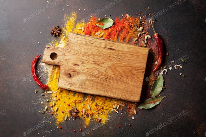 Various spices and cutting board