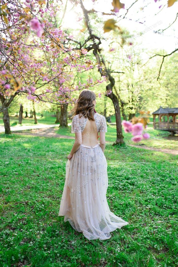 Very beautiful girl the bride beige wedding dress.