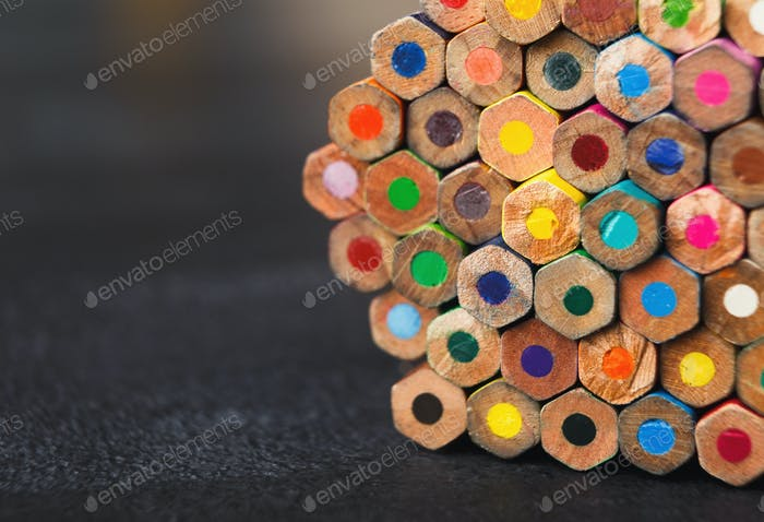Stack of colorful pencils tips, art background