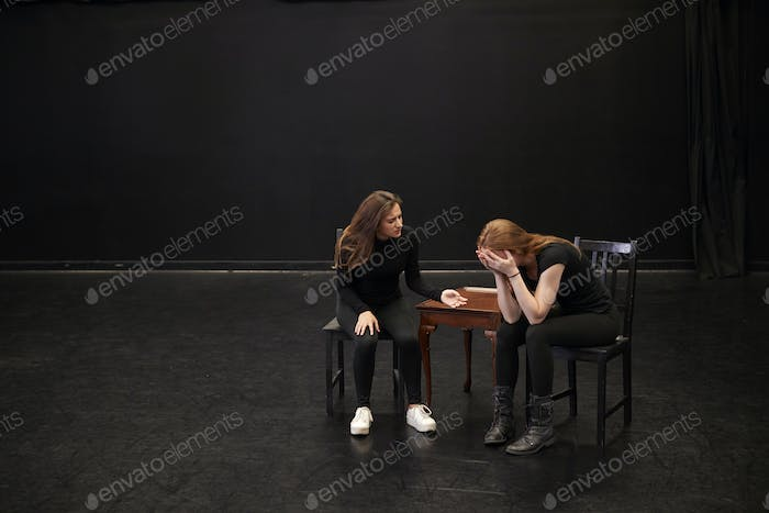 Two Female Drama Students At Performing Arts School In Studio Improvisation Class