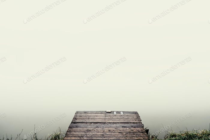 Pier foggy lake perspective