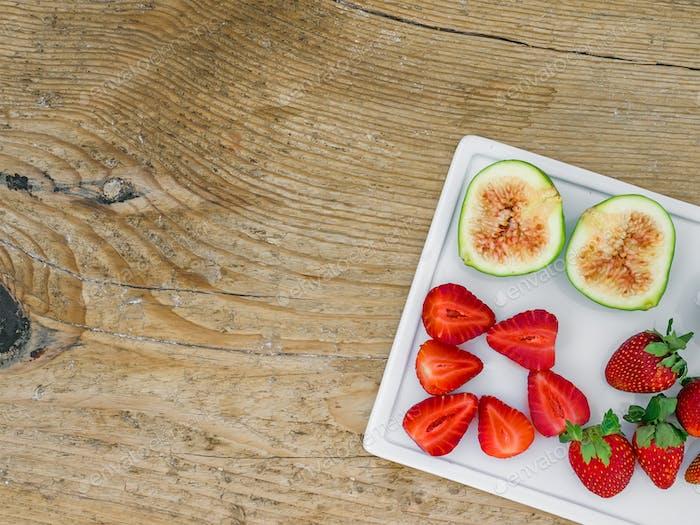 A set of fresh fruit on a wooden desk