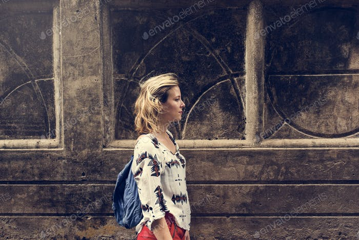 Young Woman Traveler Walking Concept