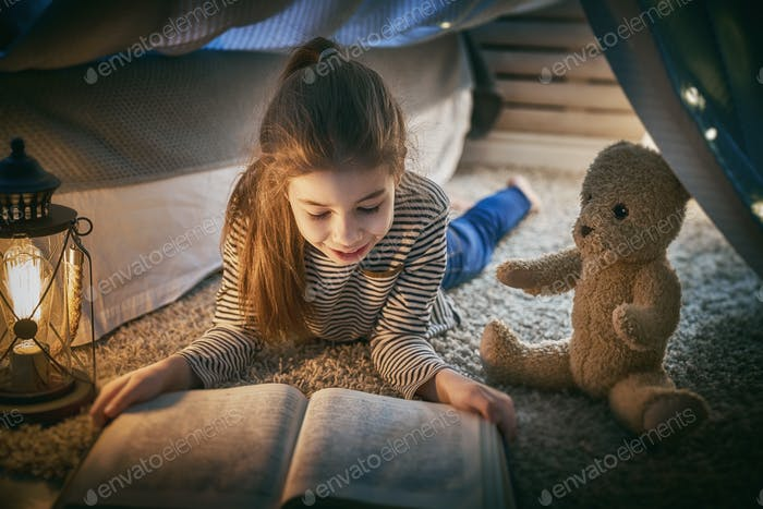 child is reading a book
