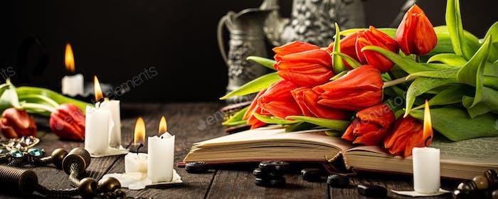 Orange tulips on old book