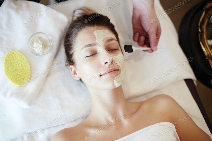 Woman Enjoying Skincare in SPA