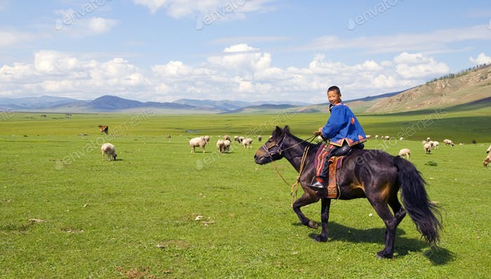 Boy Riding A Horse In A Beautiful Scenic View Of Nature