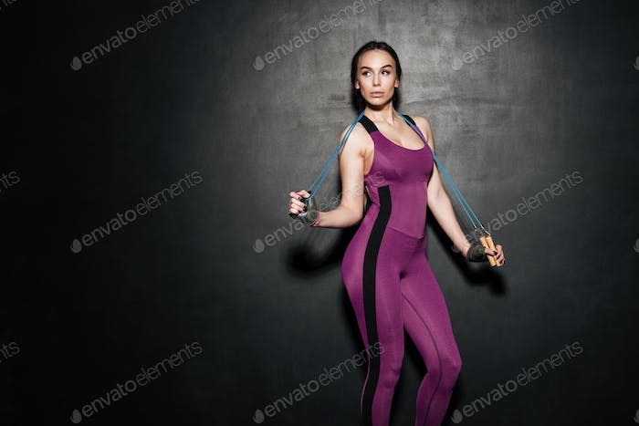 Woman in sport suit working with hand expander