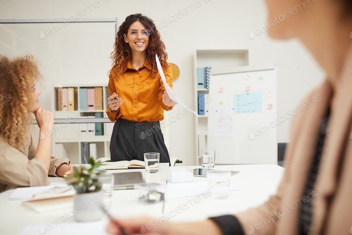 Charming Businesswoman Holding Presentation
