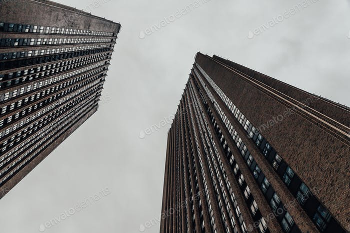 Low angle view of skyscrapers. Moody tone photography.