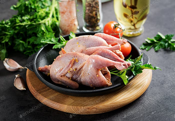 Raw uncooked quail. Ingredients for cooking healthy meat dinner.
