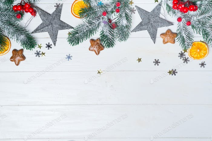 Christmas border isolated on white, composed of fresh fir branches and ornaments in red, gold and