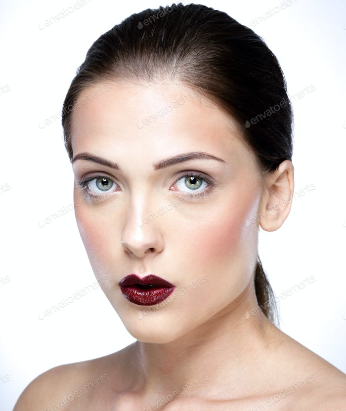 Closeup portrait of a young beautiful woman with fresh skin