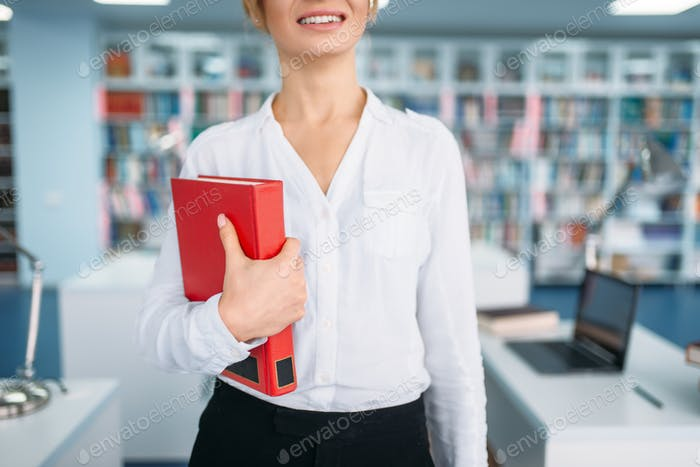Female student in glasses, university library