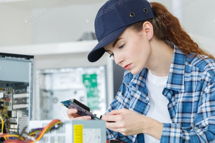 Young female computer repair person