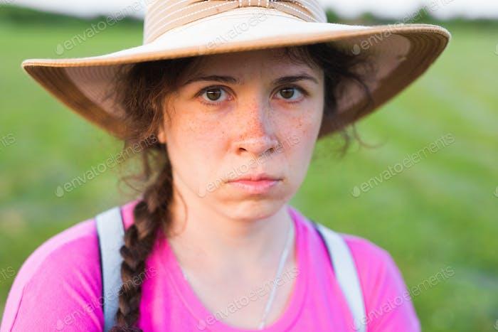 Close up portrait sad woman with freckles