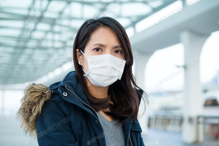 Woman suffer from illness and wearing face mask