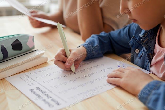 Little Girl Doing Homework Closeup