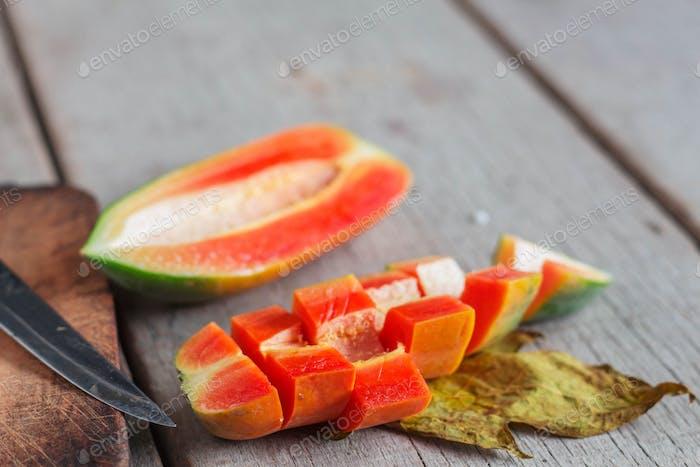 Cut of papaya on wooden