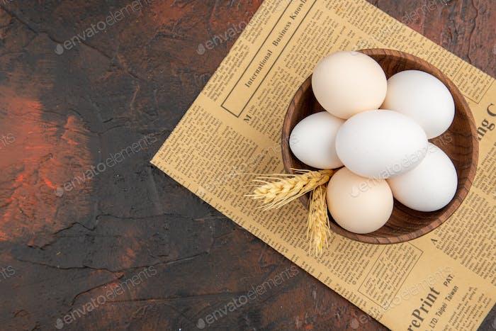 top view chicken eggs inside plate on dark background animal bird food female color photo breakfast