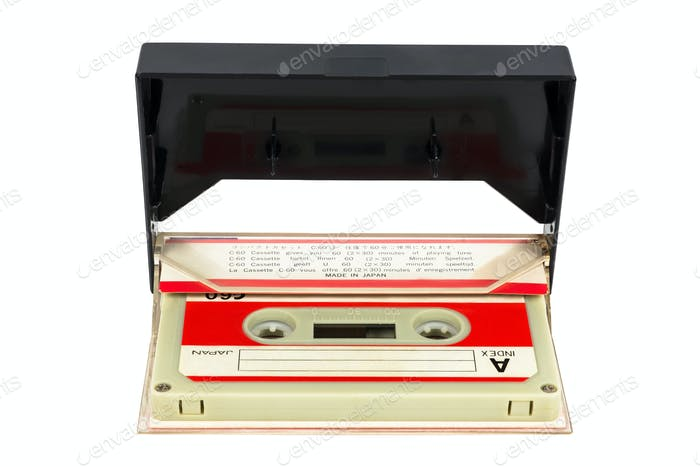 Vintage audio tape in the box on white background