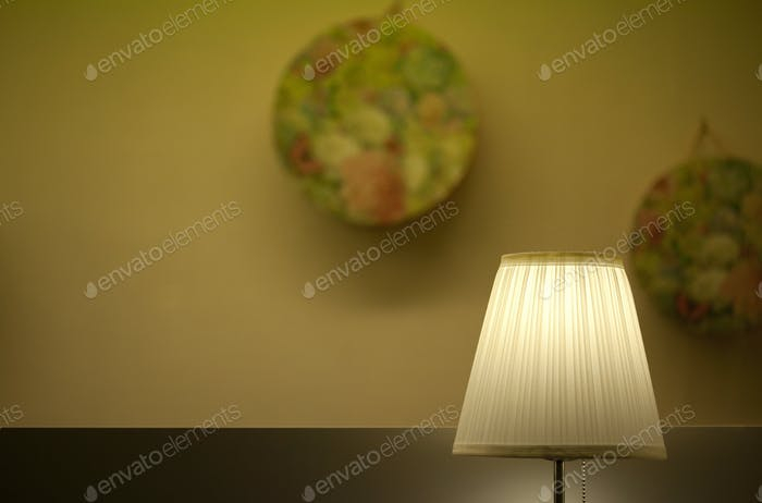 Lamp and plates in a lobby