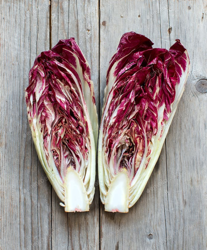 Raw red chicory on a wooden table