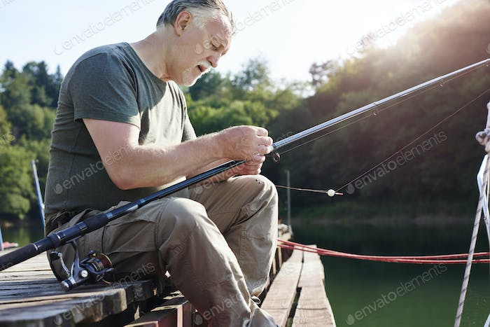 Senior men make preparations for fishing