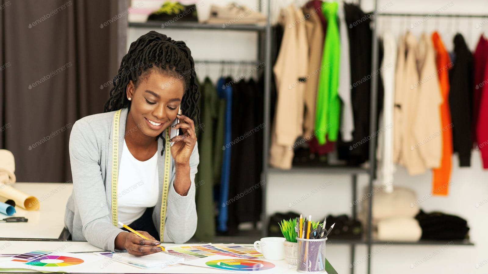 Fashion Store Assistant Receiving Phone Order Of Designer Clothes Photo By Prostock Studio On Envato Elements